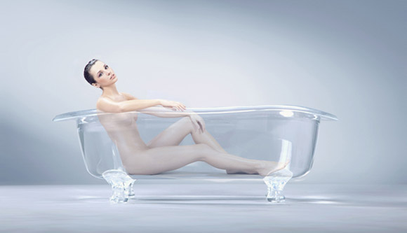 Surprisingly Content Woman in an Empty Bath
